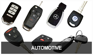 Image of a selection of automotive keys, transponder keys, remotes, and fobs.