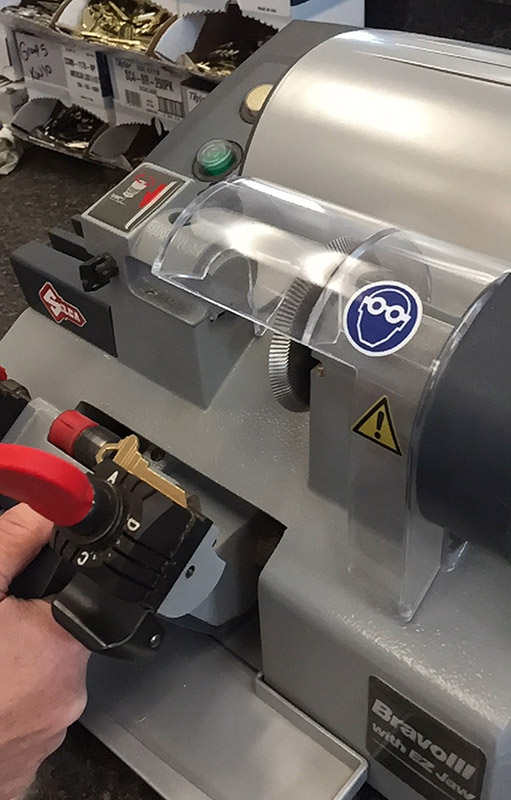 Key cutting machine in action.